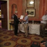 Richard Woolley presenting a certificate to......